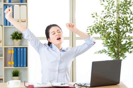 Asian businesswoman fell tired and stretching